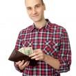 Man holding some dollars — Stock Photo