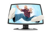 Falling young man into the screen — Stock Photo