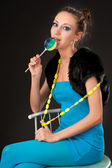 Beautiful lady with lollipop — Stock Photo