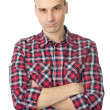 Young man with a serious look and crossed arms — Stock Photo