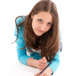 Young woman draws a pencil on a white floor — Stock Photo