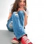Young girl sitting on floor — Stock Photo