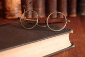 Old Eyeglasses On Bookshelf — Stock Photo