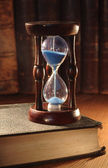 Hourglass And Old Books — Stock Photo
