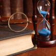 Hourglass And Old Books — Stock Photo #4128713