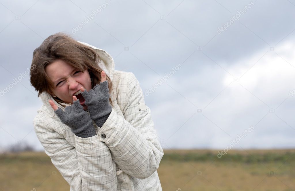 Emotional nice young girl crying on background with autumn dark sky — Stock Photo #4272744