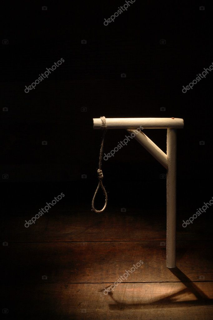 Gibbet with loop on gloomy wooden background — Stock Photo #4303592