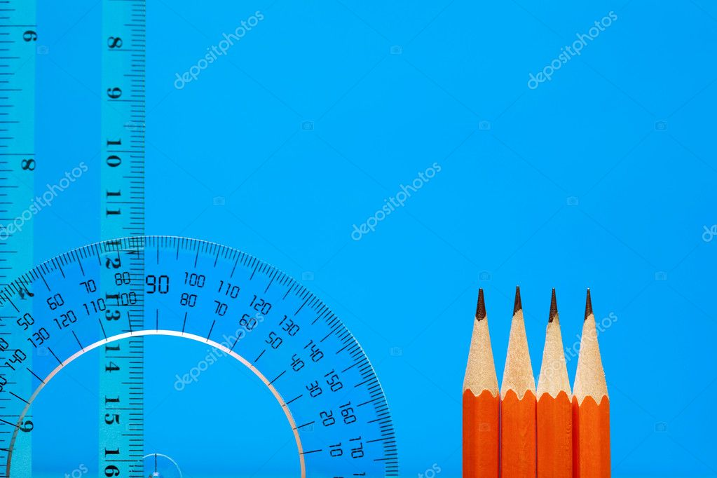 Transparent plastic protractor and ruler near pencils on blue background with copy space — Stock Photo #4532180