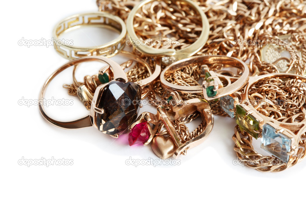 Pile of gold jewelry isolated on white background — Stock Photo #4813991