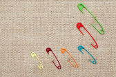 Safety Pins On Canvas — Stock Photo