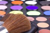 Two make-up brushes on eyeshadows palette — Stock Photo