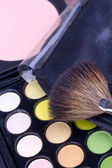 Make-up brush on multicolour eyeshadows palette — Stock Photo