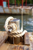 Mooring bollard with nautical rope — Stock Photo