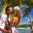 Lovers are kissing near palm tree — Stock Photo