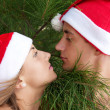 Lovers in Christmas hats — Stock Photo