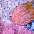 Make-up brush on crushed eyeshadows — Stock Photo #4490077