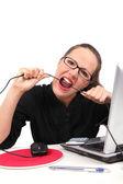 Businesswoman bitting a cable — Zdjęcie stockowe