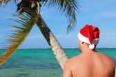 Santa looking at ocean — Stock Photo