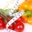 Fresh vegetables rounded by measuring tape, — Stock Photo