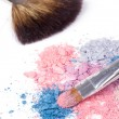 Two make-up brush on crumbled eyeshadows — Stock Photo