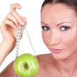 Woman with green apple rounded measuring tape — Stock Photo