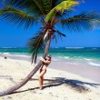 Stock Photo: Girl in bikini near palm