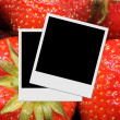 Photo frame on strawberry background — Stock Photo
