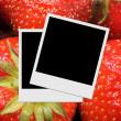 Photo frame on strawberry background — Stock Photo