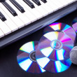 Vocal microphone,cd discs and electronic keyboard. Closeup on bl - Stock Photo