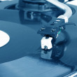 Dj needle on spinning turntable - Stock Photo