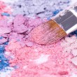 Make-up brush on crushed eyeshadows — Stock Photo #4747148