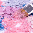 Make-up brush on crushed eyeshadows — Stock fotografie
