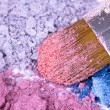 Professional make-up brush on crushed eyeshadows - Stock Photo