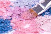 Make-up brush on crushed eyeshadows — Stock Photo