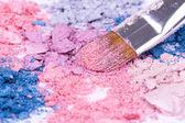 Make-up brush on crushed eyeshadows — Stock Photo