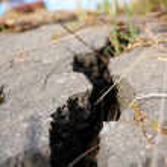 Cracked asphalt after earthquake — Stock Photo #4754021