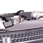 Dj needle on spinning turntable — Stock Photo #4769241