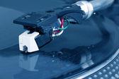 Dj needle on spinning turntable — Stock Photo
