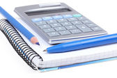 Pen and pencil on paper notebook and calculator — Stock Photo