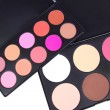 图库照片: Make-up corrector and eyeshadows palettes
