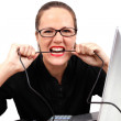 Angry businesswoman biting a cable — Stock Photo #4771982