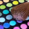 Stock Photo: Professional brush on multicolour eye shadows palette