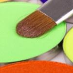 Professional brush on green eye shadows palette — Stock Photo