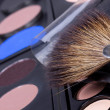 Professional make-up brush and eyeshadows palettes — Stock Photo