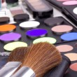 Stock Photo: Two make-up brushes on eyeshadows palettes