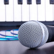Microphone, cd disks and piano keyboard - Stockfoto