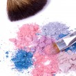Make-up brush on crushed eyeshadows - Stockfoto