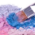 Make-up brush on crushed eyeshadows — Stock Photo #4772585