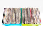 Vinyl records in plastic boxes isolated on white — Stock Photo