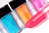 Lipstick and tubes with professional colour pigment — Stock Photo